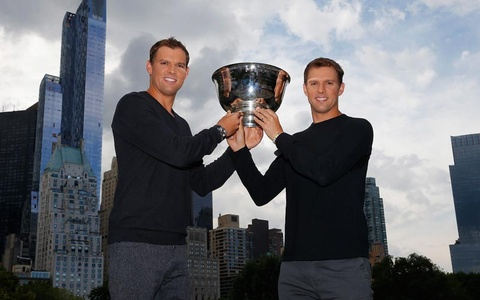 Bryan Brothers holding tennis trophy