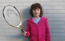 Zoe prepares to play tennis. Visit aceingautism.com for program info
